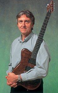 Allen Holdsworth Holding a Guitar